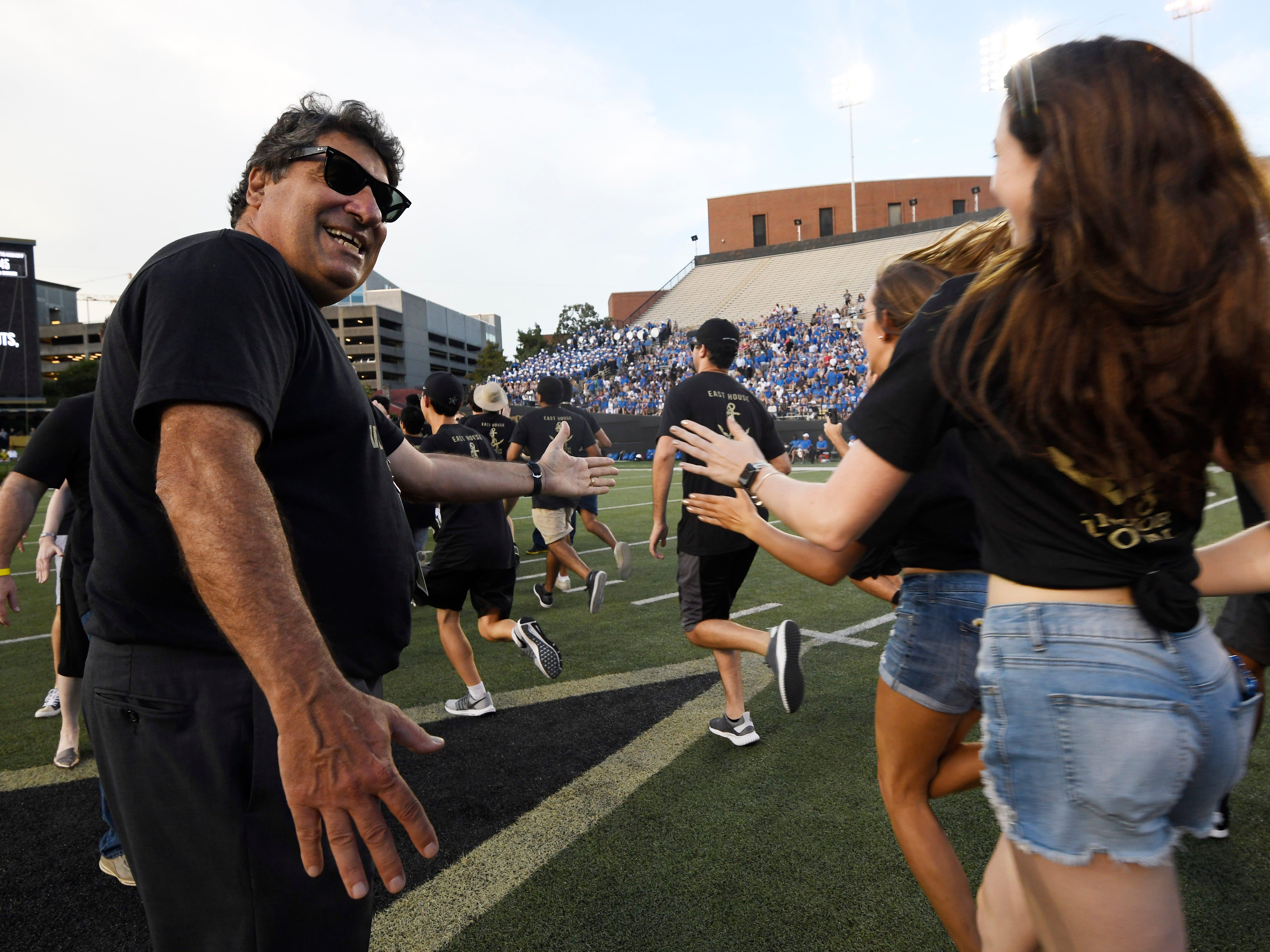 Vanderbilt Chancellor Nicholas Zeppos shakes hands with the students in the Anchor Dash before the game against MTSU at Vanderbilt Stadium Saturday, Sept. 1, 2018, in Nashville, Tenn.