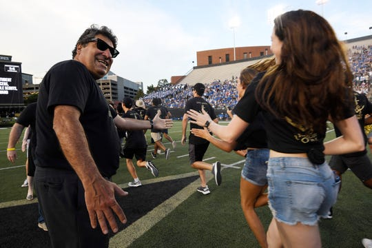Vanderbilt Chancellor Nicholas Zeppos shakes hands with students in the Anchor Dash before the game against MTSU on Sept. 1.