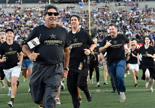 Vanderbilt Chancellor Nicholas Zeppos leads the Anchor Dash before the game against MTSU at Vanderbilt Stadium Saturday, Sept. 1, 2018, in Nashville, Tenn.