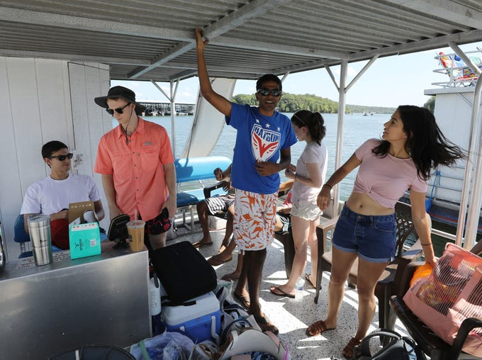 From left to right: Austin Triana, Jeremy Hatcher, Kaustav Shah, Katherine Kelly and Natalia Garza prepare for a day on Percy Priest Lake while getting set up with their boat rental at Elm Hill Marina Sunday September 2, 2018.