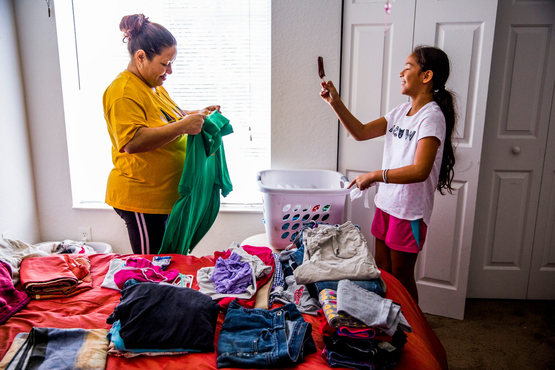 Ludi Rivera folds laundry with her daughter Alexia Trevino, 10, in their Immokalee apartment on Sunday, Sept. 2, 2018. The family's home was destroyed during Hurricane Irma last year and they are staying in an apartment until their home is rebuilt by several charities, including the Guadalupe Center, where Rivera works.