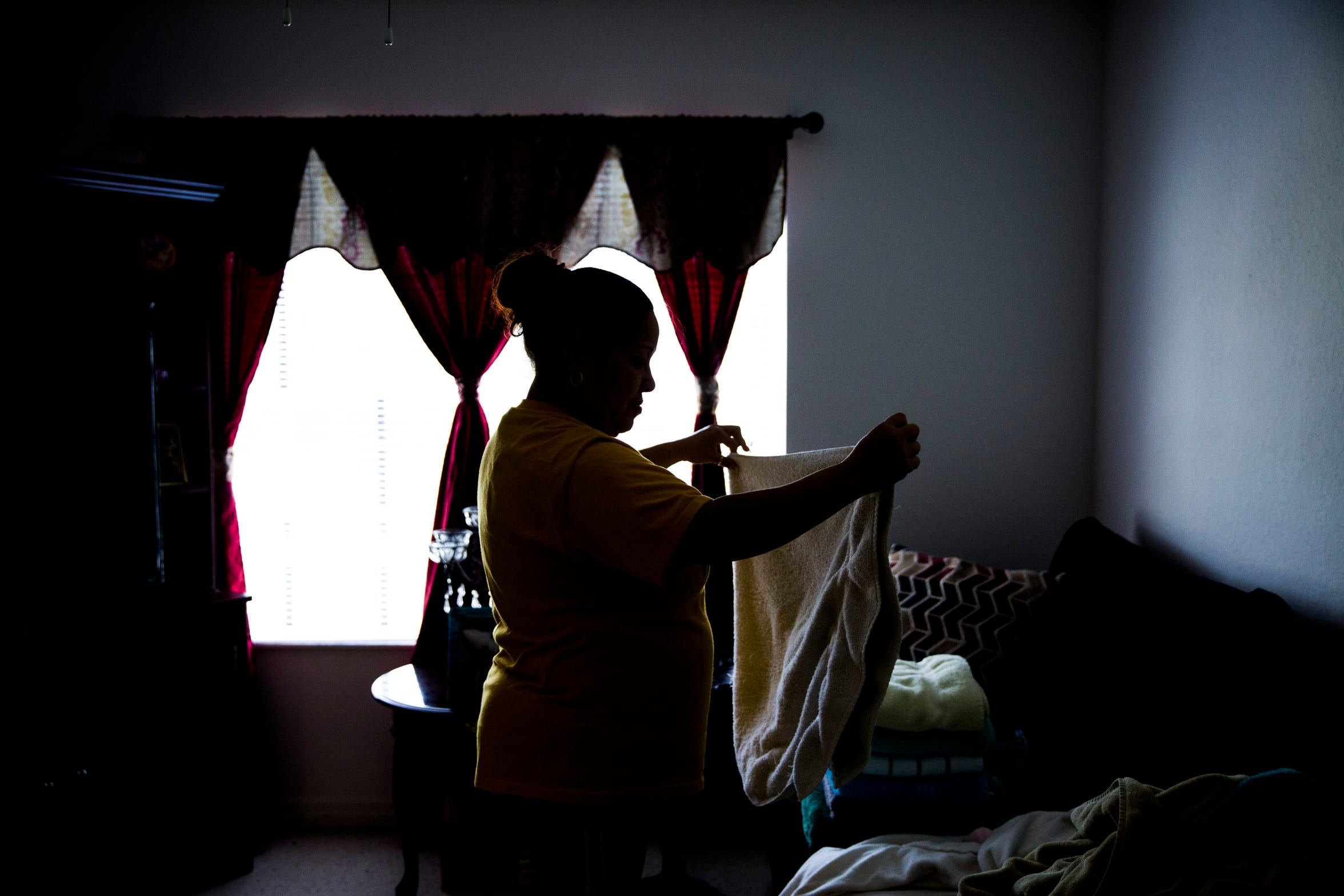 Ludi Rivera folds laundry in her Immokalee apartment on Sunday, Sept. 2, 2018. The family's home was destroyed during Hurricane Irma last year and they are staying in an apartment until their home is rebuilt by several charities, including the Guadalupe Center, where Rivera works.