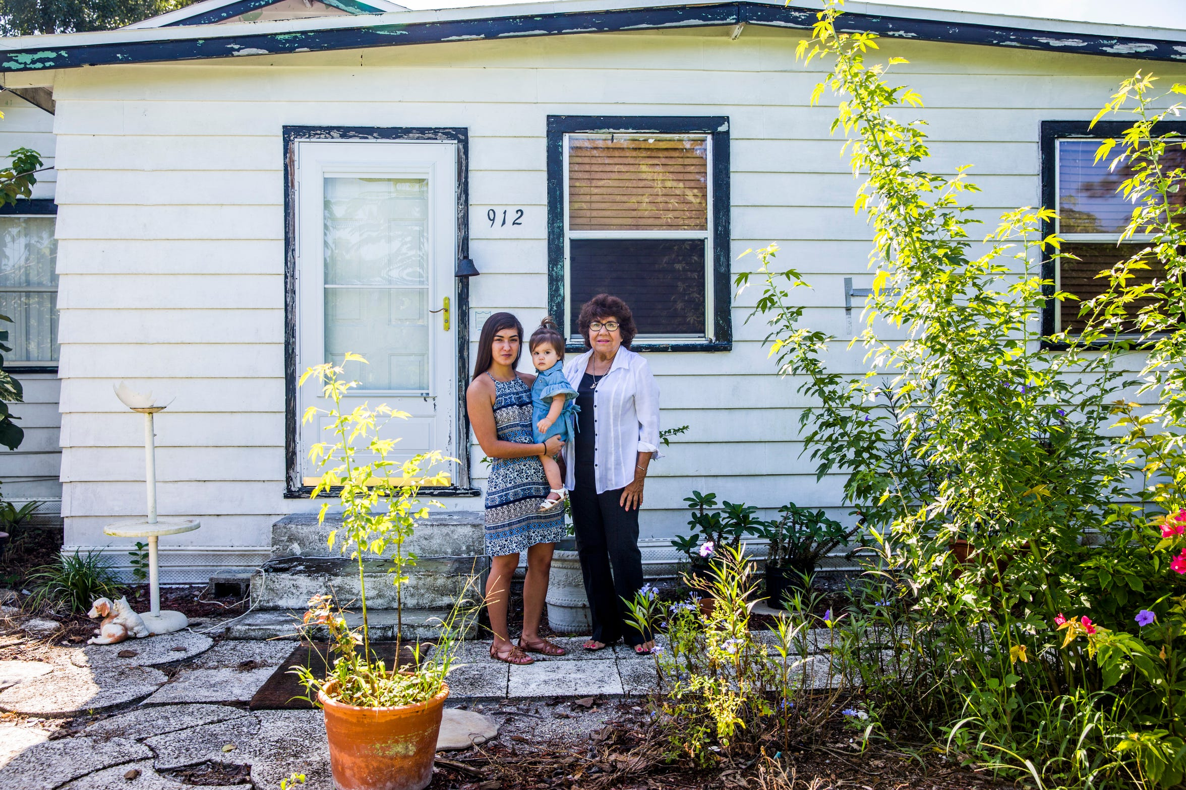Norma Contreras, right, her great-granddaughter Arianna Contreras, 1, and Arianna's mother, Andreane Herrera, in front of their Immokalee home on Saturday, Sept. 1, 2018. Groups including United Methodist Committee on Relief, the Salvation Army, Rural Neighborhoods and the Mennonites Disaster Service repaired their home after it was severely damaged during Hurricane Irma last year.