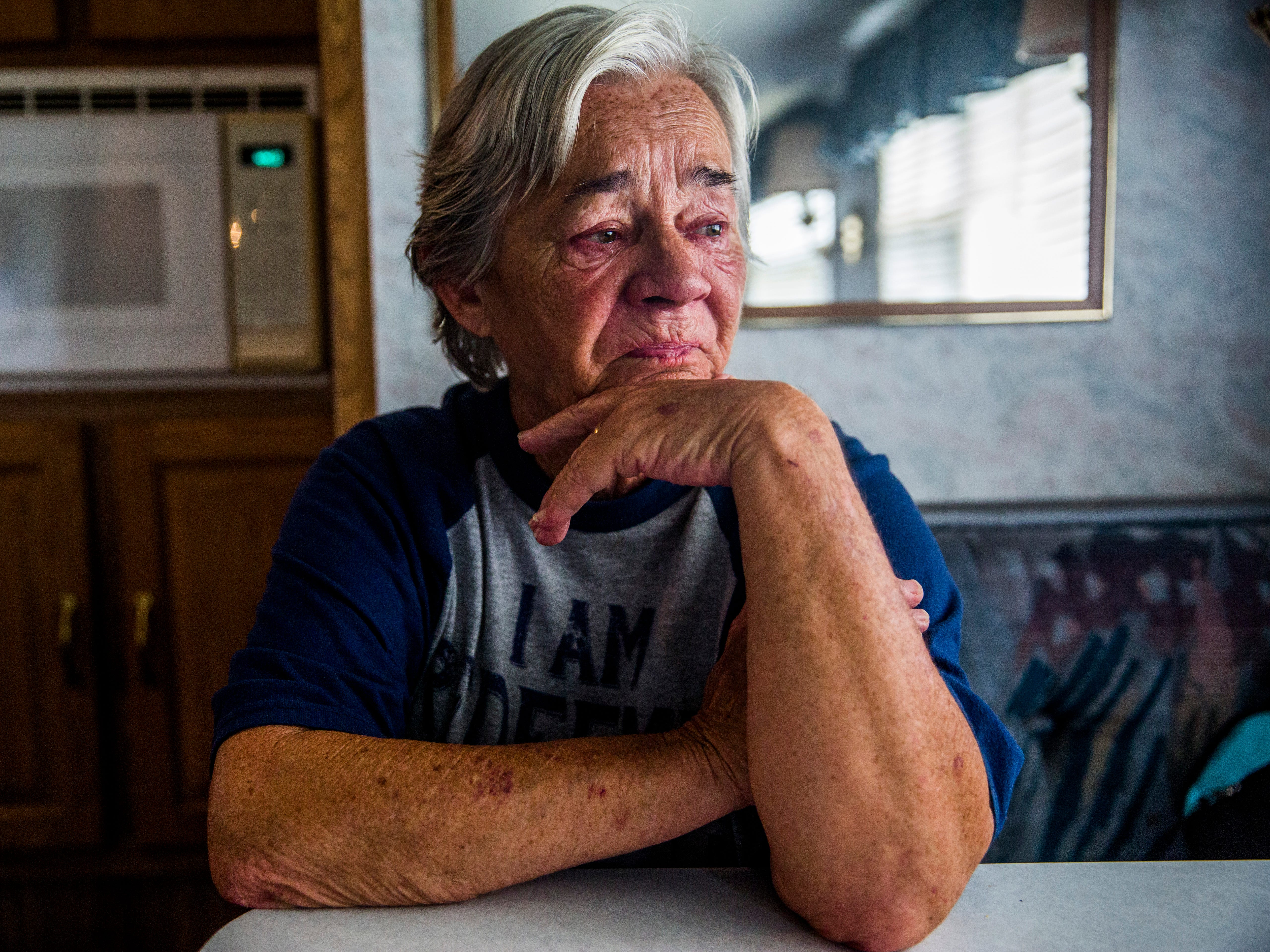 "Debbie Coe, 62, becomes emotional as she talks about losing her Immokalee home when Hurricane Irma hit a year ago, while sitting in her temporary Immokalee home on Wednesday, Aug. 22, 2018. Coe has custody of her 6-year-old great-nephew and has been caring for him alone since her husband died in February 2017. They are staying in an RV while they wait for their home to be rebuilt by the Guadalupe Center. Coe's home will be the nonprofit's first home rebuild port-Irma. ""I have a roof over my head. My stove don't work, my refrigerator don't work, but I have a roof over my head,"" Coe says."