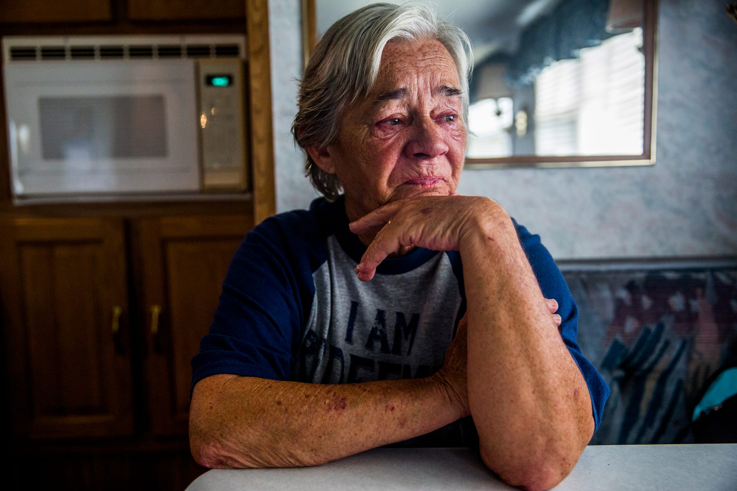 """Debbie Coe, 62, becomes emotional as she talks about losing her Immokalee home when Hurricane Irma hit a year ago, while sitting in her temporary Immokalee home on Wednesday, Aug. 22, 2018. Coe has custody of her 6-year-old great-nephew and has been caring for him alone since her husband died in February 2017. They are staying in an RV while they wait for their home to be rebuilt by the Guadalupe Center. Coe's home will be the nonprofit's first home rebuild port-Irma. """"I have a roof over my head. My stove don't work, my refrigerator don't work, but I have a roof over my head,"""" Coe says."""