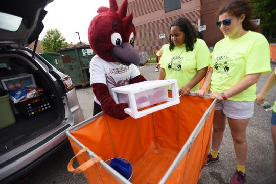 Ramapo Mascot Road Runner, together with volunteer students including, Merytel Rodriguez (center) load belongings of an incoming student into a cart during Ramapo Moving In Day outside in Mahwah on 09/02/18.