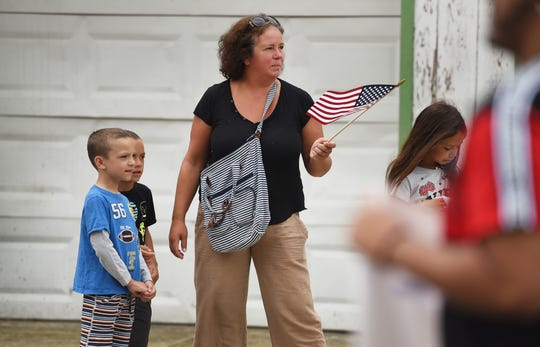 Jeanine Newman of North Haledon watches the parade with her three children (L to R) Nick (in blue), A.J. (in black) and Sofie (R) during the 26th Annual Labor Day Parade in Haledon on 09/02/18.
