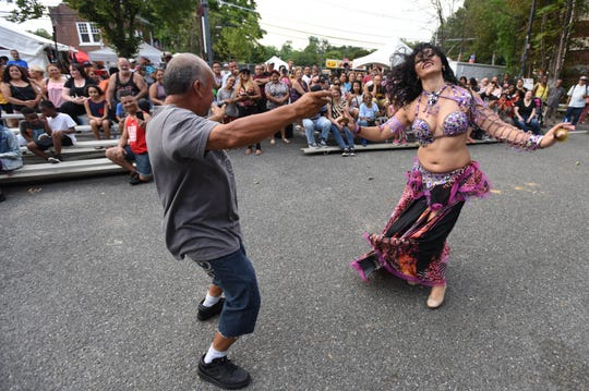 """Belly dancer """"Krystal"""" performing at the Great Falls Festival in Paterson"""