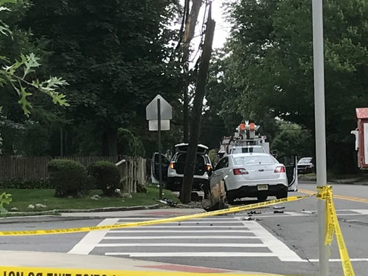 Unmarked police car crashes in Ridgewood