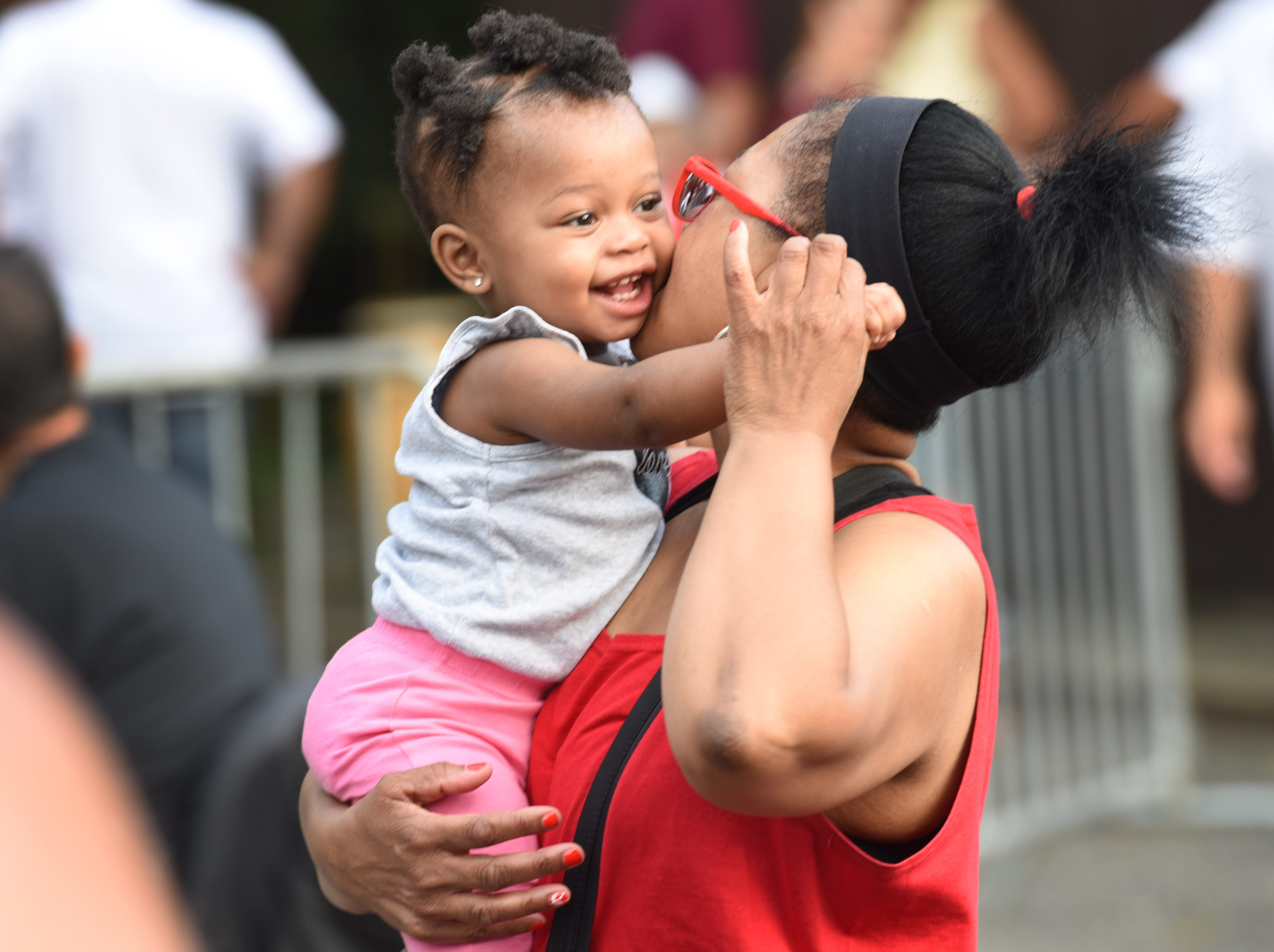 Wendy Glover dancing with her great-grand-son, year-old Wynter Nazareth, at the Great Falls Festival in Paterson