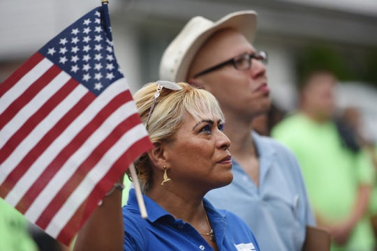 Sayda M. Tunanama (foreground), Vice President of American Workers Association and Daniel L. Ulloa, President of the A.W.A listen to a speech outside of the American Labor Museum at the beginning of the 26th Annual Labor Day Parade in Haledon on 09/02/18.