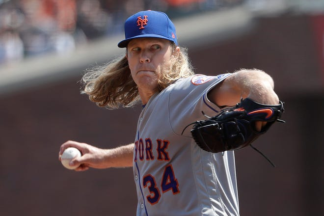 New York Mets pitcher Noah Syndergaard (34) throws against the San Francisco Giants during the second inning of a baseball game in San Francisco, Sunday, Sept. 2, 2018.