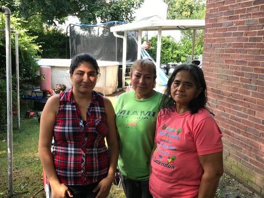 "Ana Bolanos, center, with her daughter, Jennifer Sosa, left, and her sister, Maria Bolanos, right. Ana was dozing in a her backyard hammock when she smelled smoke coming from next door. ""At first, I thought it was a bar-b-que,"" she said."