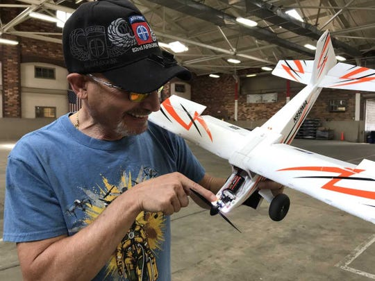 John Victor Jacobson, 61, of Clark, gets ready to fly a model airplane at the Westfield National Guard Armory.