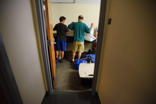 Freshman student Daniel Frank of Closter, moves into his dorm room as his father Ray helps him to make up his bed during Ramapo Moving In Day in Mahwah on 09/02/18.
