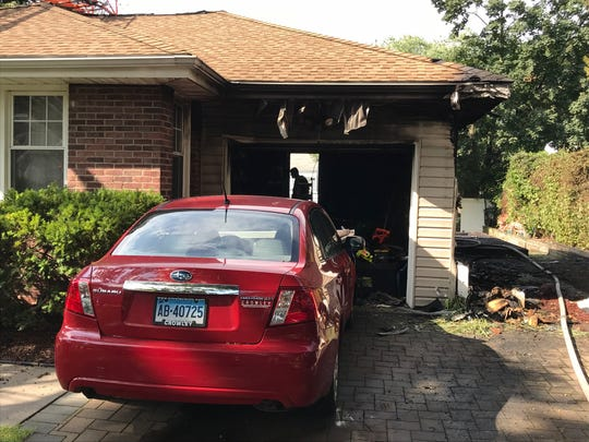 The flames came close to this car parked in the driveway.