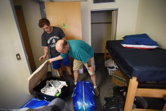 Freshman student Daniel Frank of Closter, moves into his dorm room as his father Ray helps him organize during Ramapo Moving In Day in Mahwah on 09/02/18.