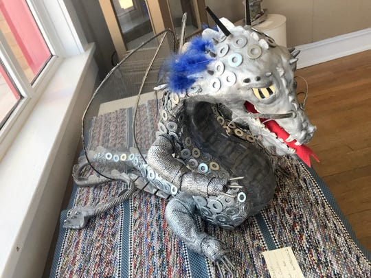"Marci Coulson's ""Silver Dragon"" drew quite a response during Sunday's Artists' Reception at the Deming Art Center."