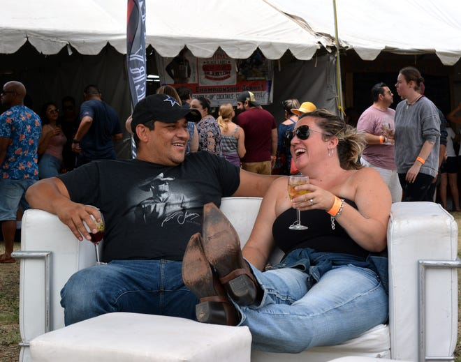 Roman Ortiz and Vanessa Ortiz from Casa Grande, Arizona, take a break during the Las Cruces Harvest Wine Festival on Sunday, Sept. 2, 2018.