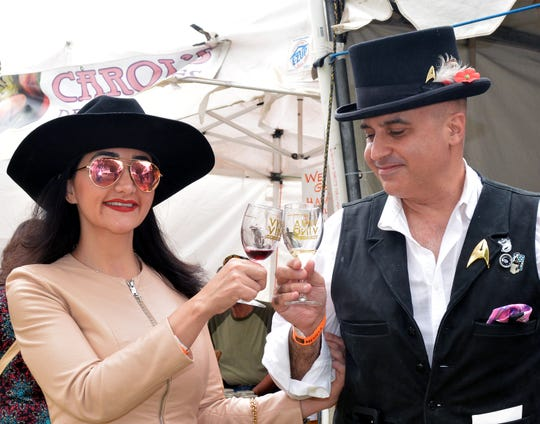 Sasa Maiwand and Seph Naficy, transplants from Los Angeles, enjoy their first visit Sunday, Sept. 2, 2018, to the Las Cruces Harvest Wine Festival.