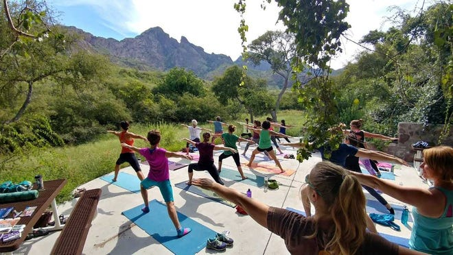 Participants at 2017's Monuments to Main Street's Yoga in the Monument practice at Dripping Springs Natural Area. Yoga events are once again a part of this year's activities.