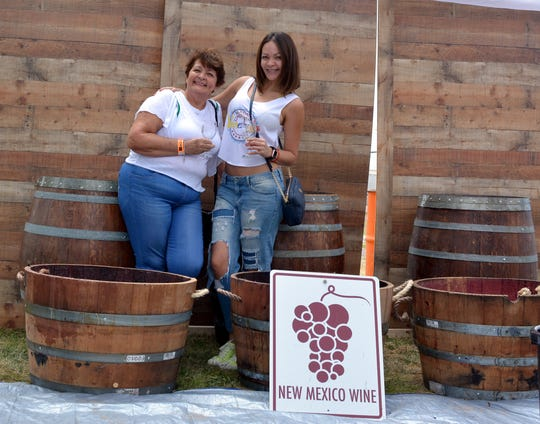 Lourdes De Jesus, left, and Eilight De Jesus, who both recently moved to Cuidad Juarez from Venezuela, enjoy posing for their family and friends at the photo booth at the Las Cruces Harvest Wine Festival on Sunday, Sept. 2, 2018.