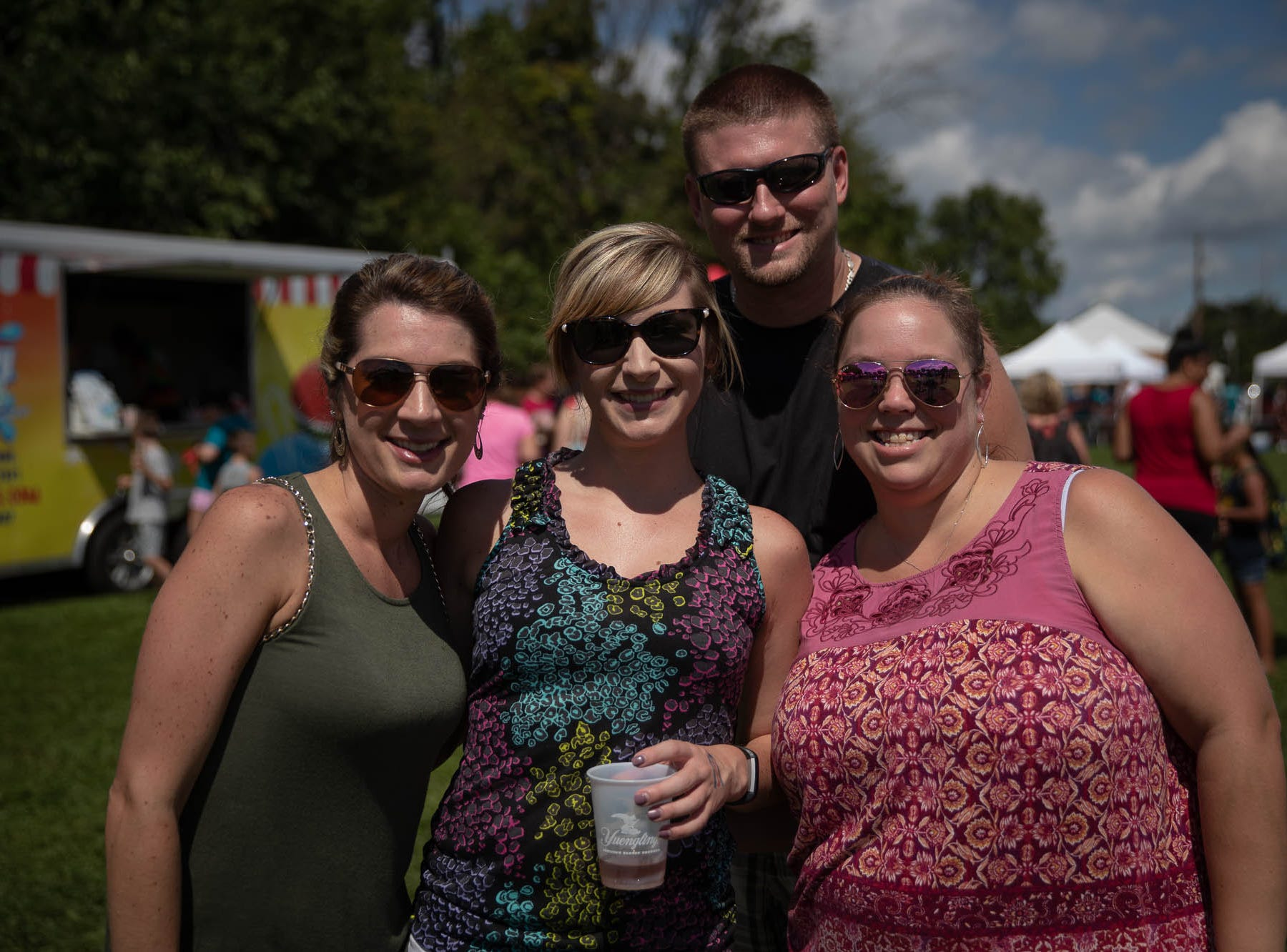 Ashley Szwoyer, Brooke Lippi, Chris Ort, and Jennifer Ort pose for a photo during the 23rd Annual Hanover Chili Cook Off, Sunday, Sept. 2, 2018, at Good Field in Hanover.