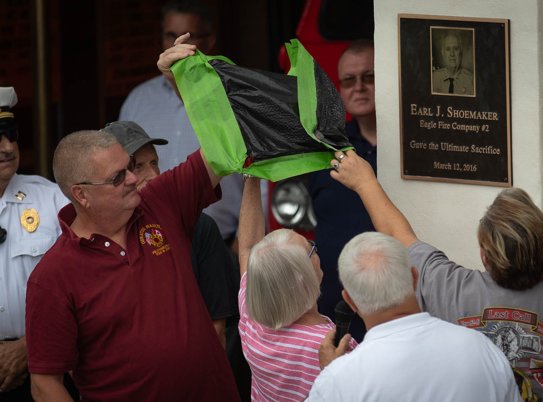 Firefighter Jim Startzel and Theresa Shoemaker, wife of fallen firefighter Earl Shoemaker, unveil a plaque in remembrance of Shoemaker during the dedication ceremony for the new Greater Hanover Area Fire Museum, Saturday, Sept. 1, 2018, in Hanover. Earl Shoemaker, a 43-year volunteer of Eagle Fire Company, died in the line of duty while responding to a structure fire March 12, 2016.