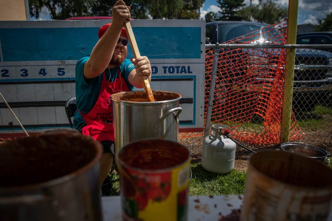 """Cody """"Fat Chuck Jr. in Training"""" Klinedinst, of McSherrystown, stirs some of """"Fat Chuck's World Famous Road Kill Chili"""" during the 23rd Annual Hanover Chili Cook Off, Sunday, Sept. 2, 2018, at Good Field in Hanover. """"Fat Chuck,"""" Klinedinst's grandfather, has been competing in the chili cook off since the beginning 23 years ago."""