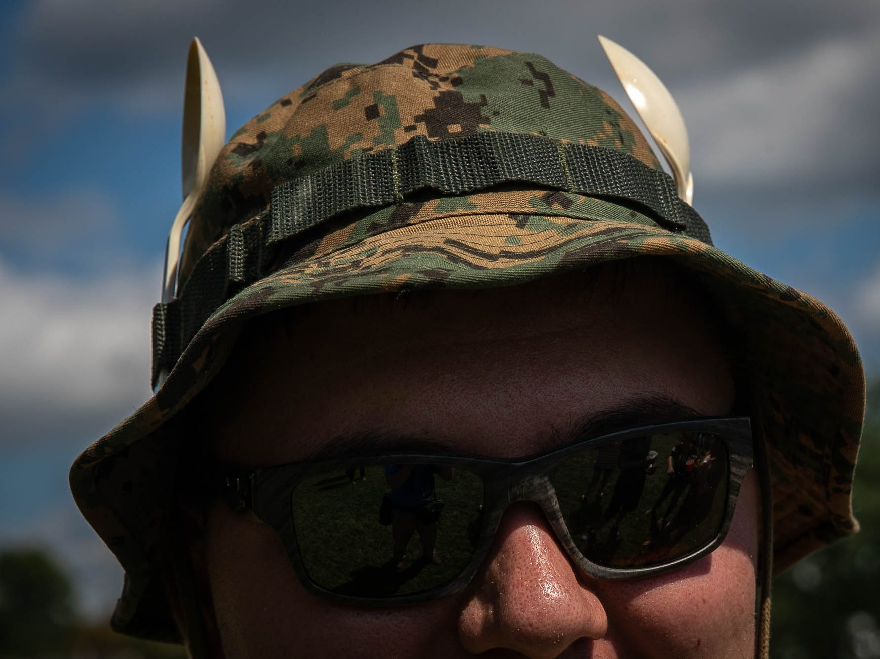 Two spoons adorn the fishing hat of Devin Smith, of Hanover, during the 23rd Annual Hanover Chili Cook Off, Sunday, Sept. 2, 2018, at Good Field in Hanover.