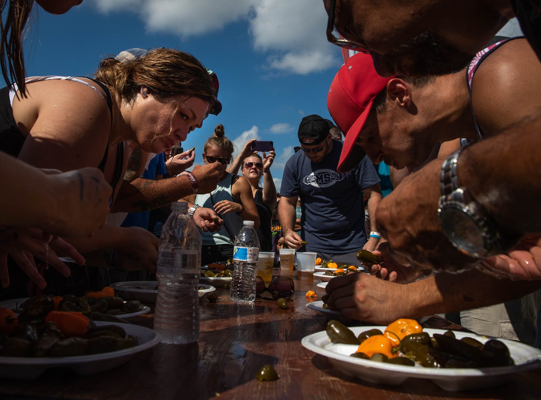 Contestants dig in during a jalapeño pepper-eating contest during the 23rd Annual Hanover Chili Cook Off, Sunday, Sept. 2, 2018, at Good Field in Hanover.