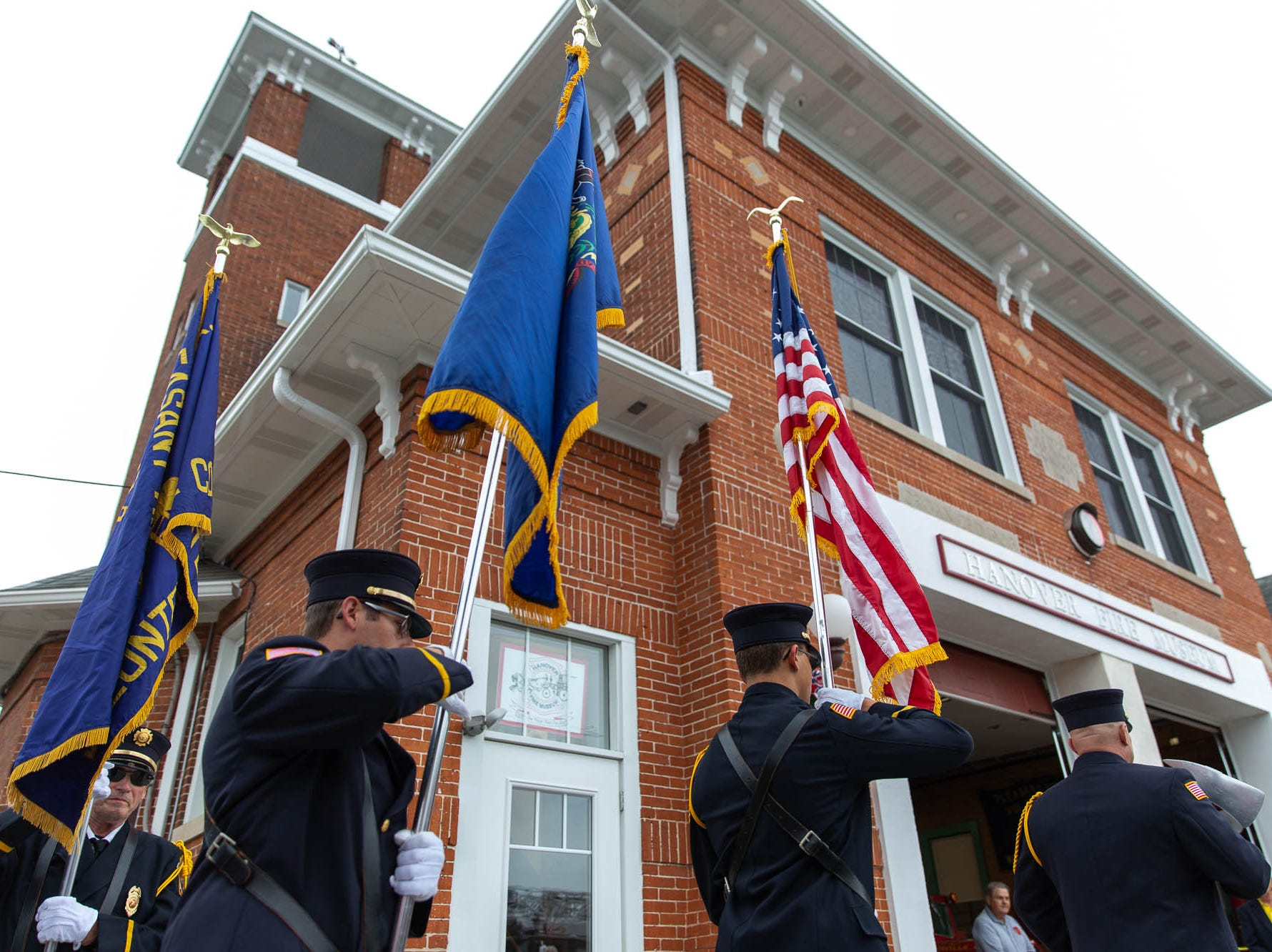 Firefighters from Pleasant Hill Fire Company present the colors as the honor guard during the dedication ceremony for the new Greater Hanover Area Fire Museum, Saturday, Sept. 1, 2018, in Hanover.