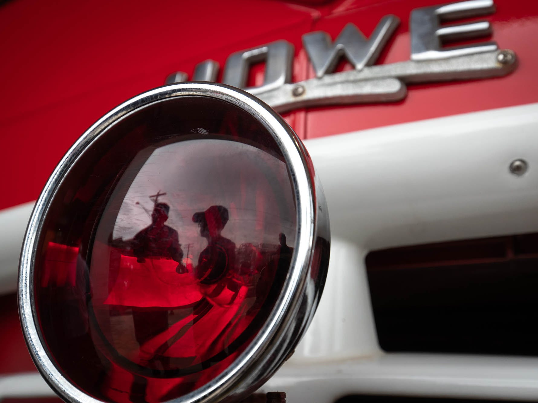 Visitors are reflected in an emergency light of a 1961 Hanover fire department Howe fire engine in the new Greater Hanover Area Fire Museum, Saturday, Sept. 1, 2018, in Hanover.