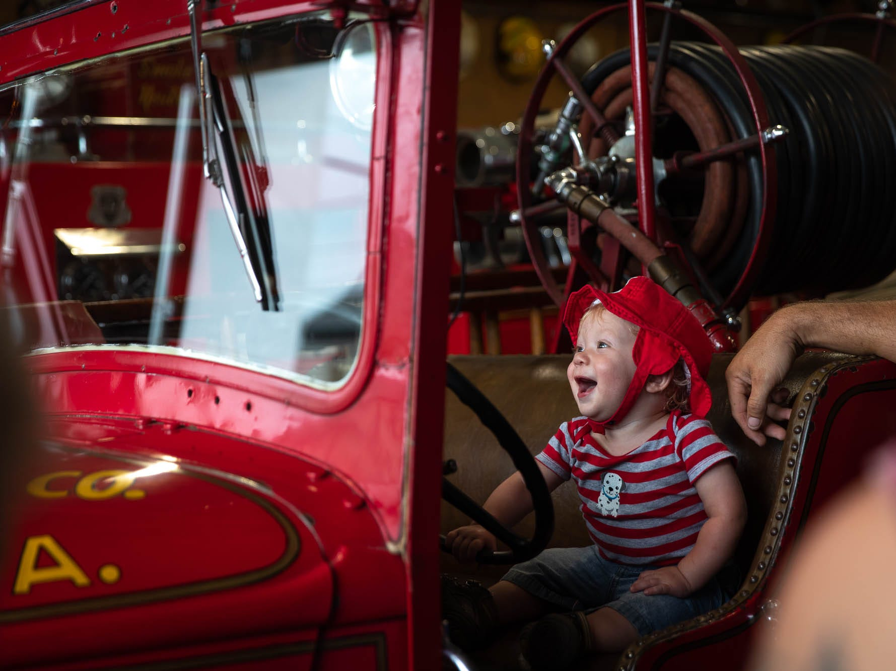 Henry Vandewater, who turned one Sunday, sits in the driver's seat of Pennville Fire Company's 1934 Dodge Buffalo engine after the dedication ceremony for the new Greater Hanover Area Fire Museum, Saturday, Sept. 1, 2018, in Hanover.