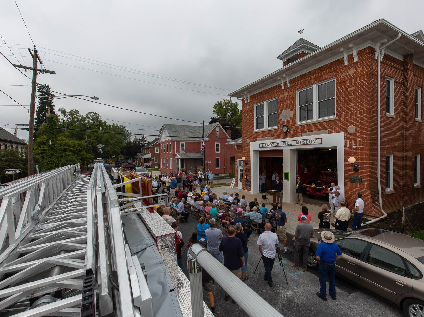 A crowd gathers on Hanover Street during the dedication ceremony for the new Greater Hanover Area Fire Museum, Saturday, Sept. 1, 2018, in Hanover.