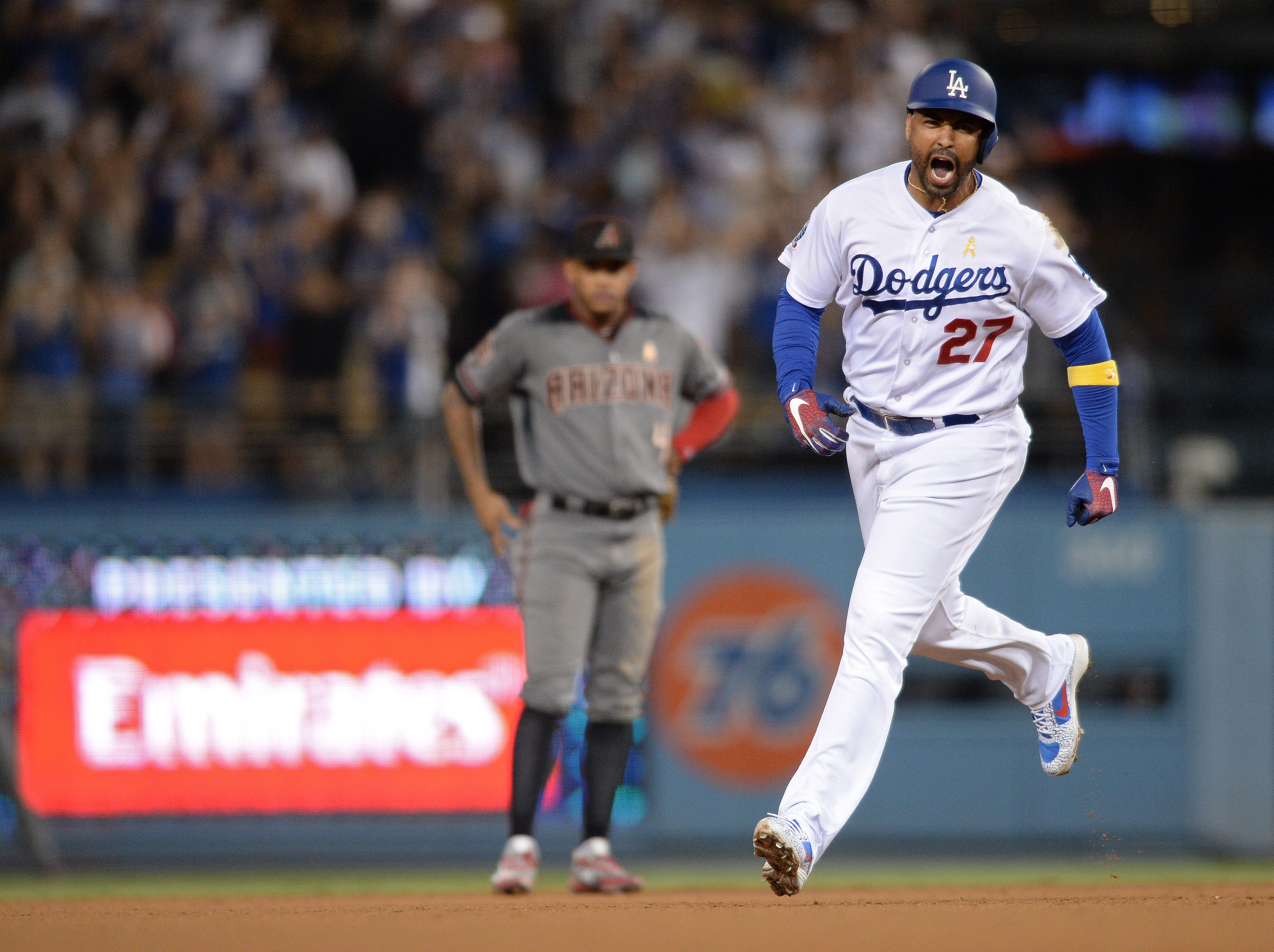 Sep 1, 2018; Los Angeles, CA, USA; Los Angeles Dodgers left fielder Matt Kemp (27) reacts as he rounds the bases after hitting a three-run home run during the eighth inning as Arizona Diamondbacks second baseman Ketel Marte (4) looks on at Dodger Stadium.