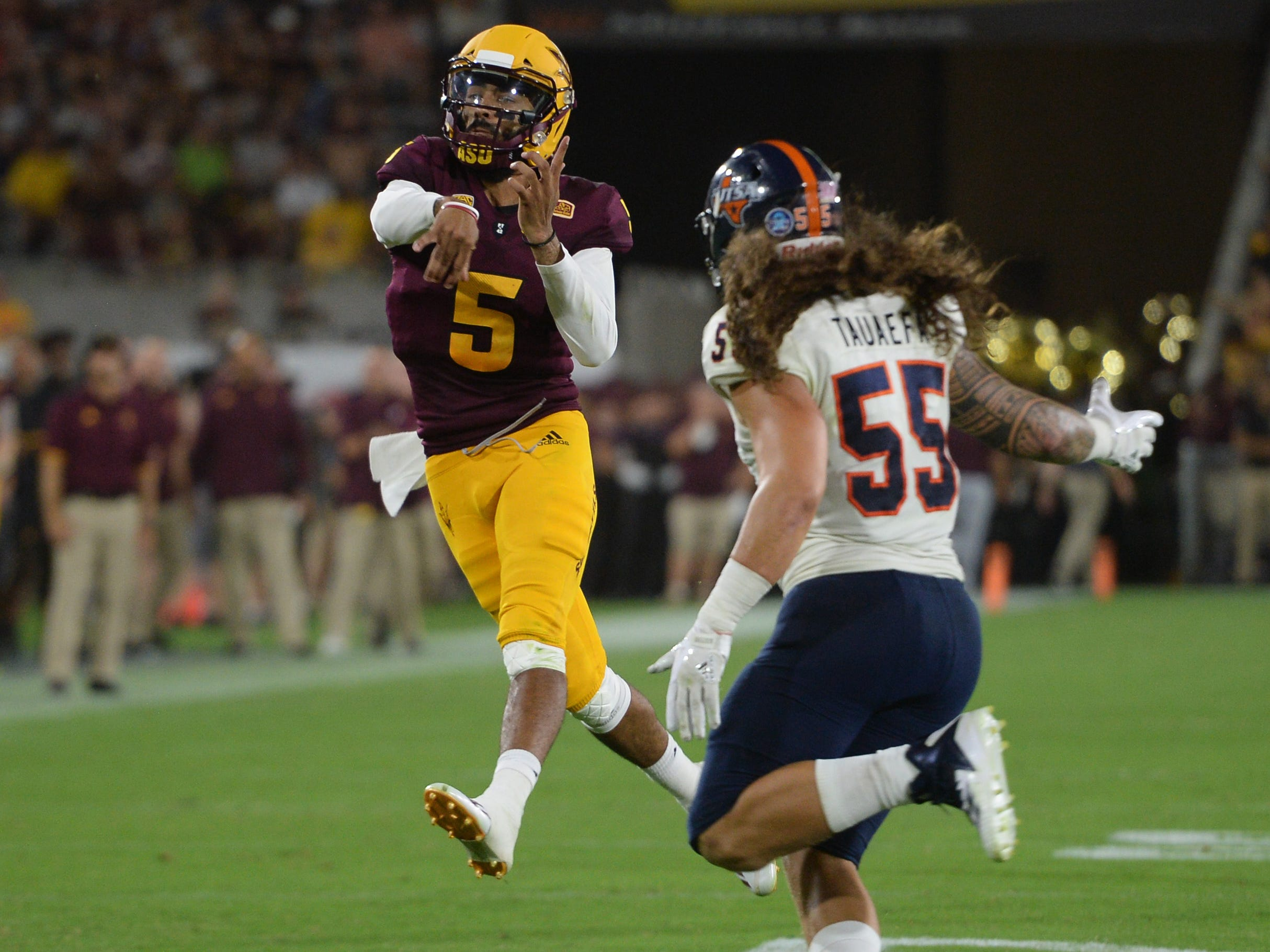 Sep 1, 2018; Tempe, AZ, USA; Arizona State Sun Devils quarterback Manny Wilkins (5) throws a touchdown pass against the UTSA Roadrunners during the first half at Sun Devil Stadium.