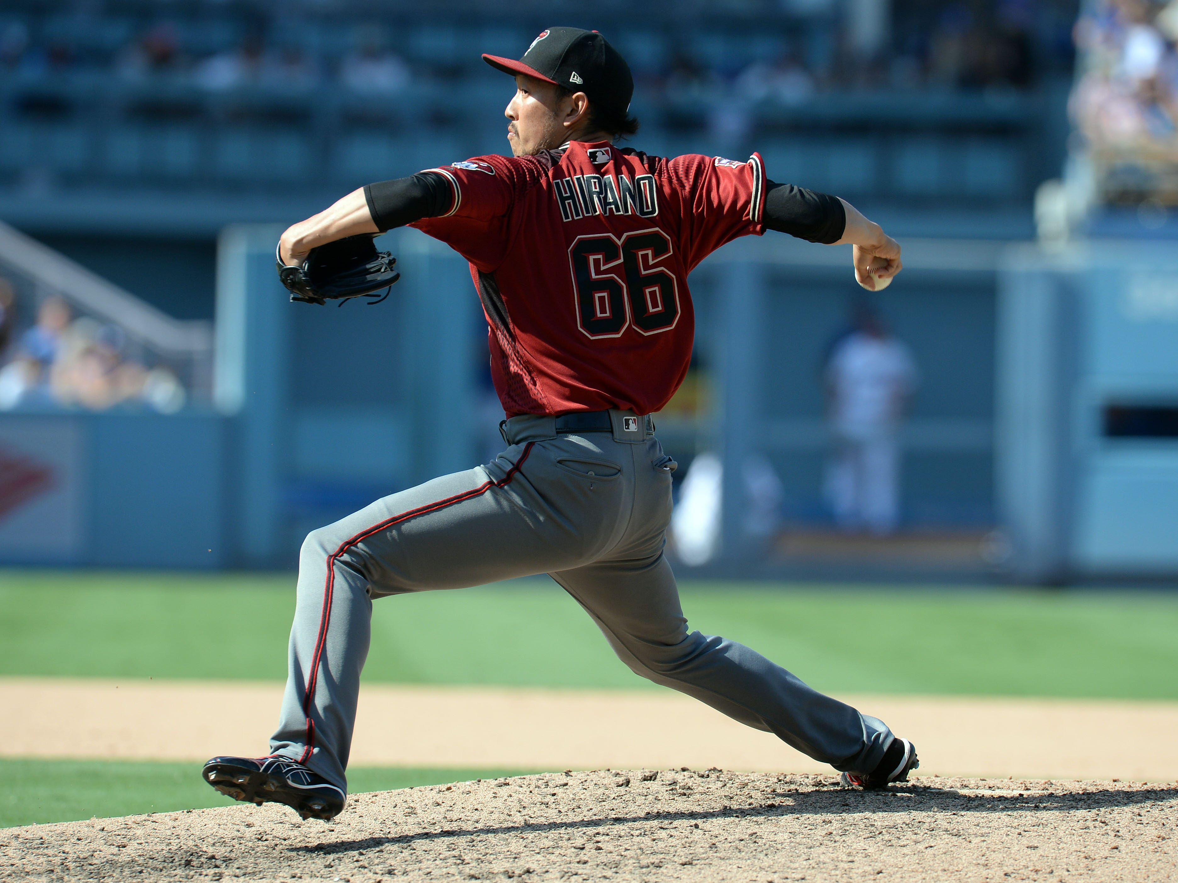 September 2, 2018; Los Angeles, CA, USA; Arizona Diamondbacks relief pitcher Yoshihisa Hirano (66) throws against the Los Angeles Dodgers in the seventh inning at Dodger Stadium. Mandatory Credit: Gary A. Vasquez-USA TODAY Sports