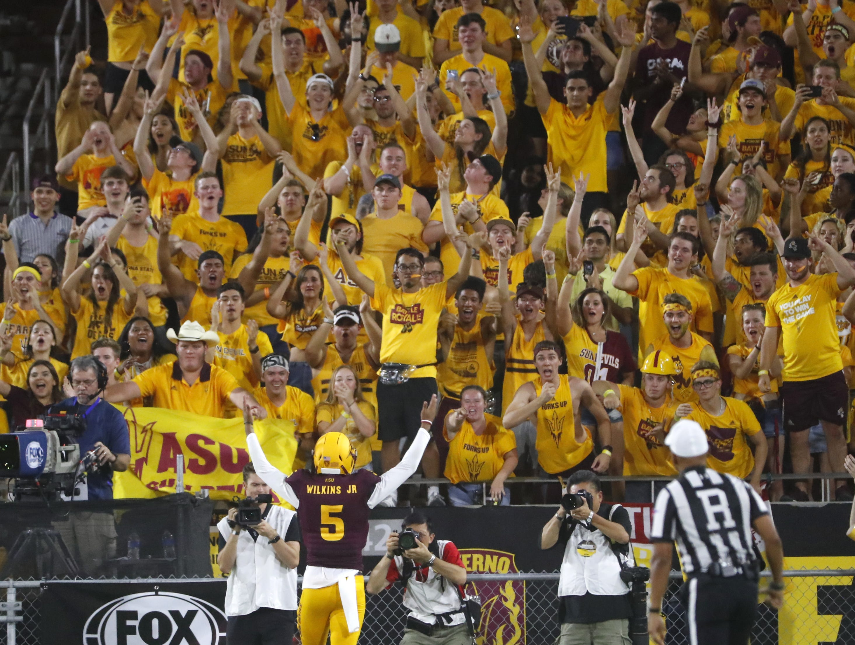 Arizona State Sun Devils quarterback Manny Wilkins (5) celebrates with the fans after ASU scored against UTSA during the second quarter at Sun Devil Stadium in Tempe, Ariz. on Sept. 1, 2018.
