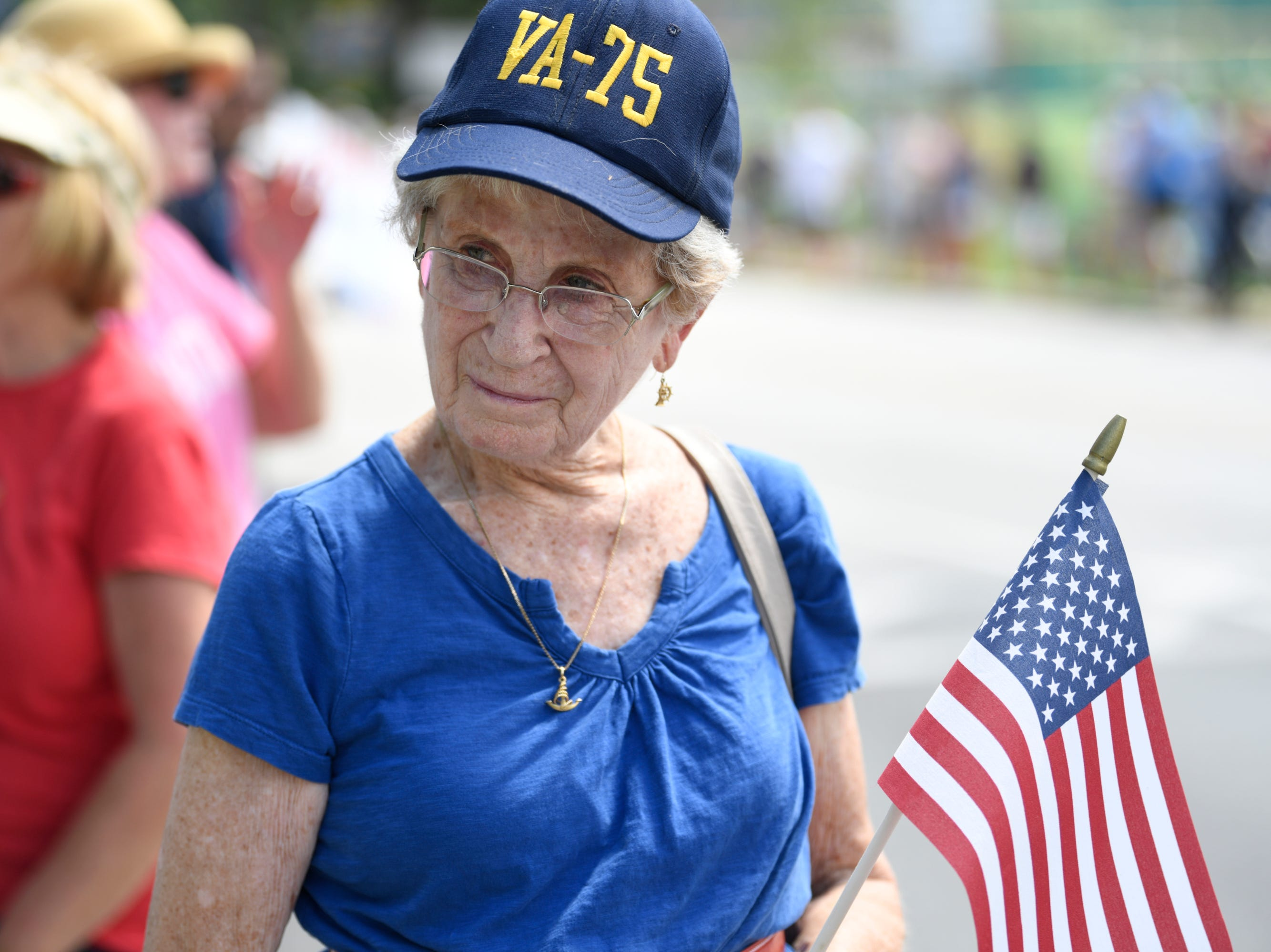 Ann Hewitt of Annapolis, Maryland waits to watch the passing of John McCain's motorcade on his way to be laid to rest at the U.S. Naval Academy.