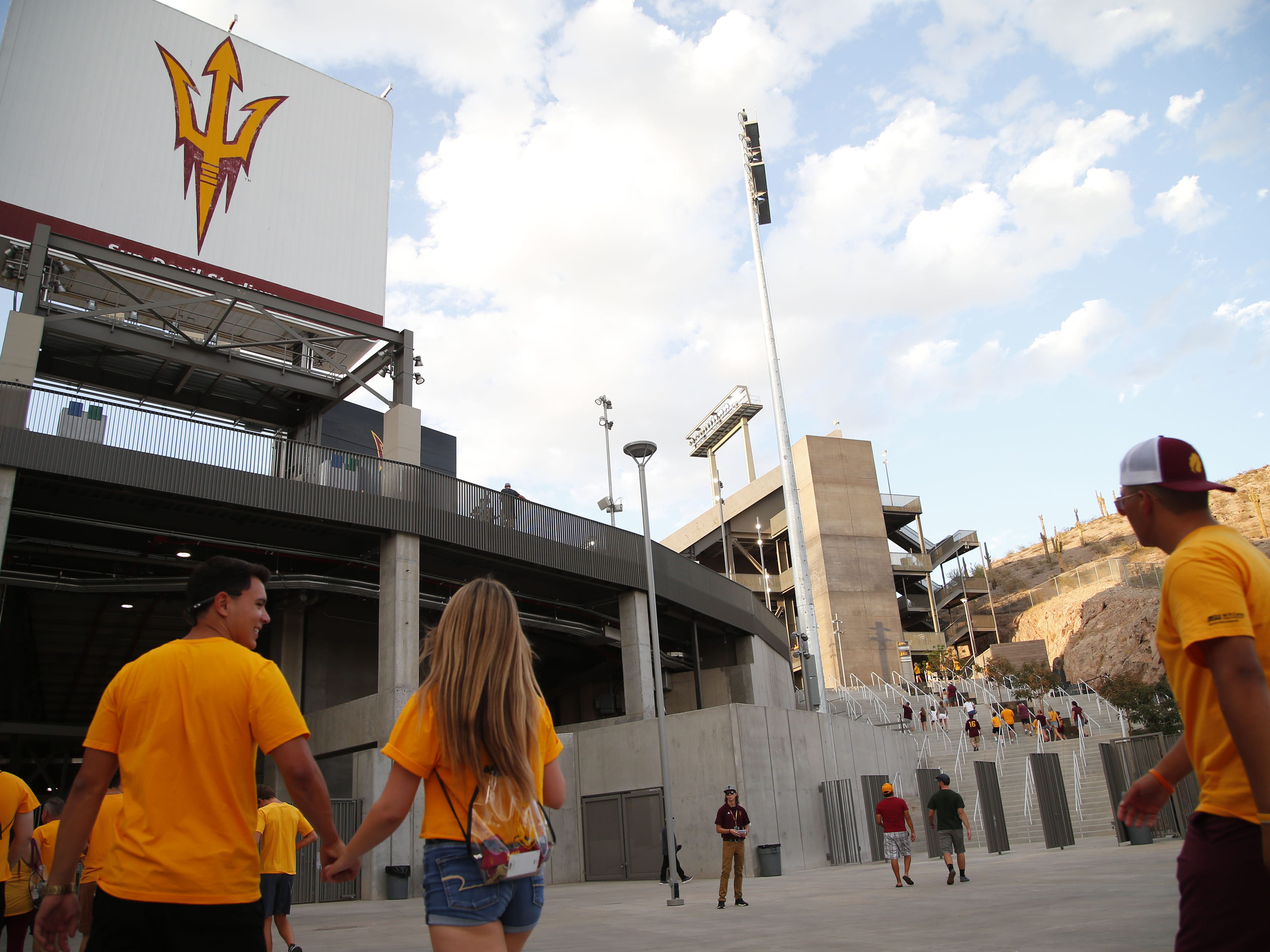 ASU fans enter the southeast side of the stadium before a football game at Sun Devil Stadium in Tempe on September 1, 2018.