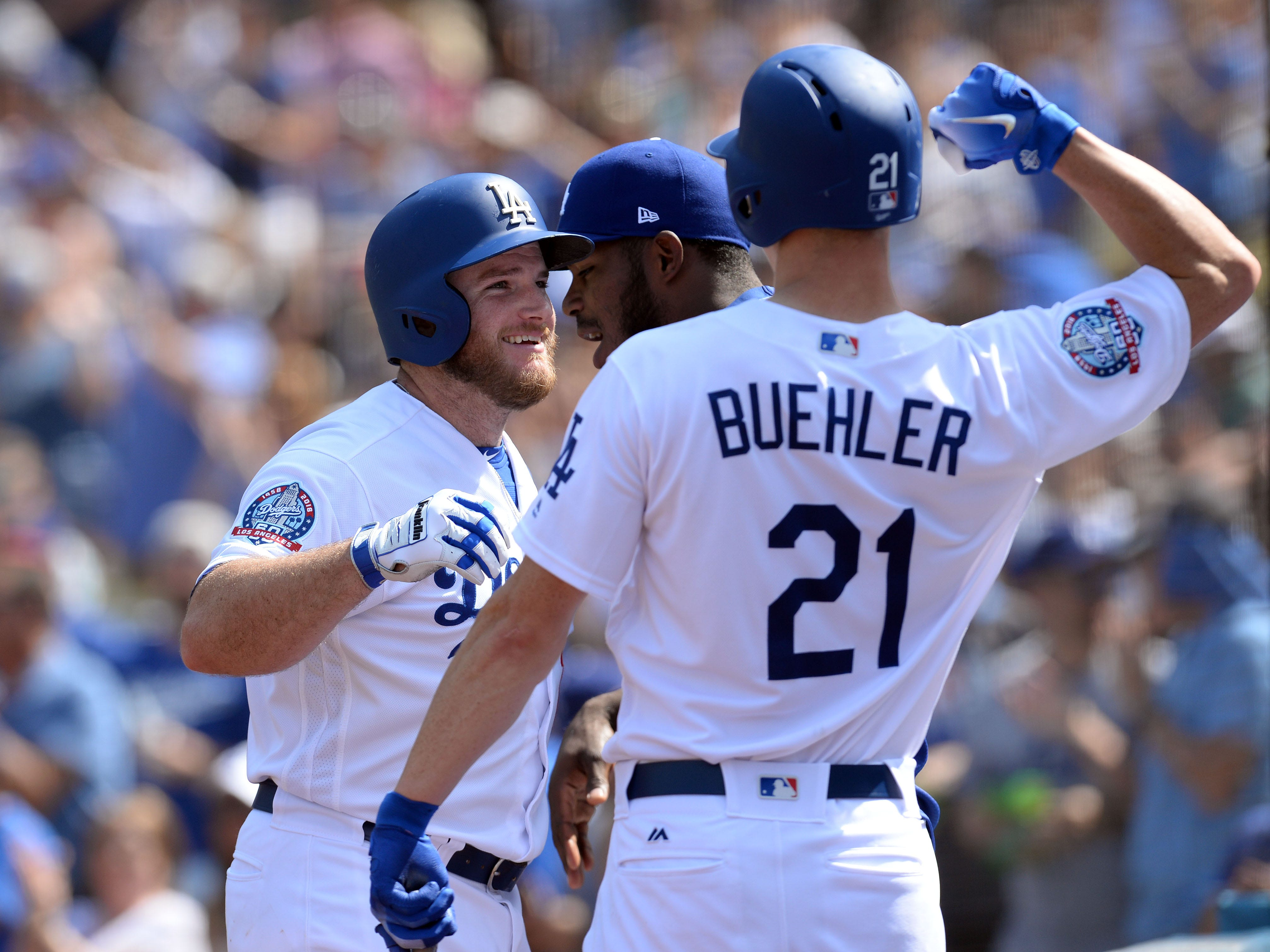 September 2, 2018; Los Angeles, CA, USA; Los Angeles Dodgers first baseman Max Muncy (13) celebrates with starting pitcher Walker Buehler (21) and right fielder Yasiel Puig (66) after hitting a solo home run against the Arizona Diamondbacks in the fifth inning at Dodger Stadium. Mandatory Credit: Gary A. Vasquez-USA TODAY Sports