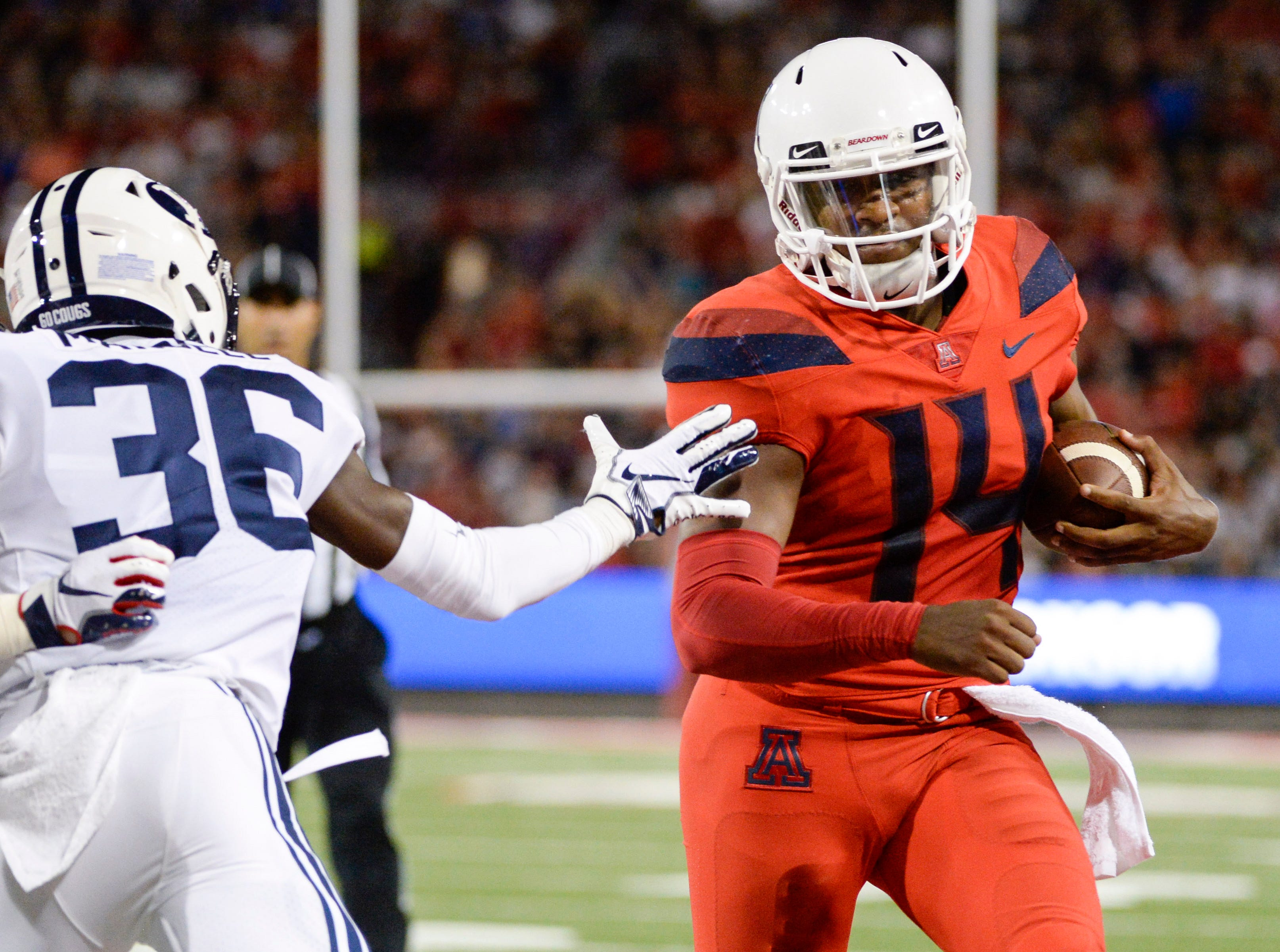 Sep 1, 2018; Tucson, AZ, USA; Arizona Wildcats quarterback Khalil Tate (14) runs the ball against Brigham Young Cougars defensive back D'Angelo Mandell (36) during the first half at Arizona Stadium.