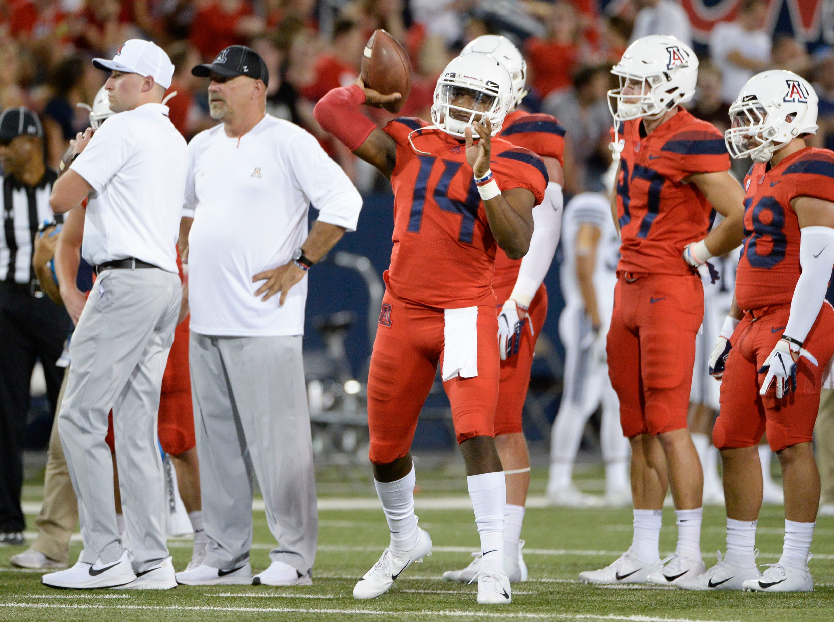 Sep 1, 2018; Tucson, AZ, USA; Arizona Wildcats quarterback Khalil Tate (14) passes the ball during warmups before playing the Brigham Young Cougars at Arizona Stadium.