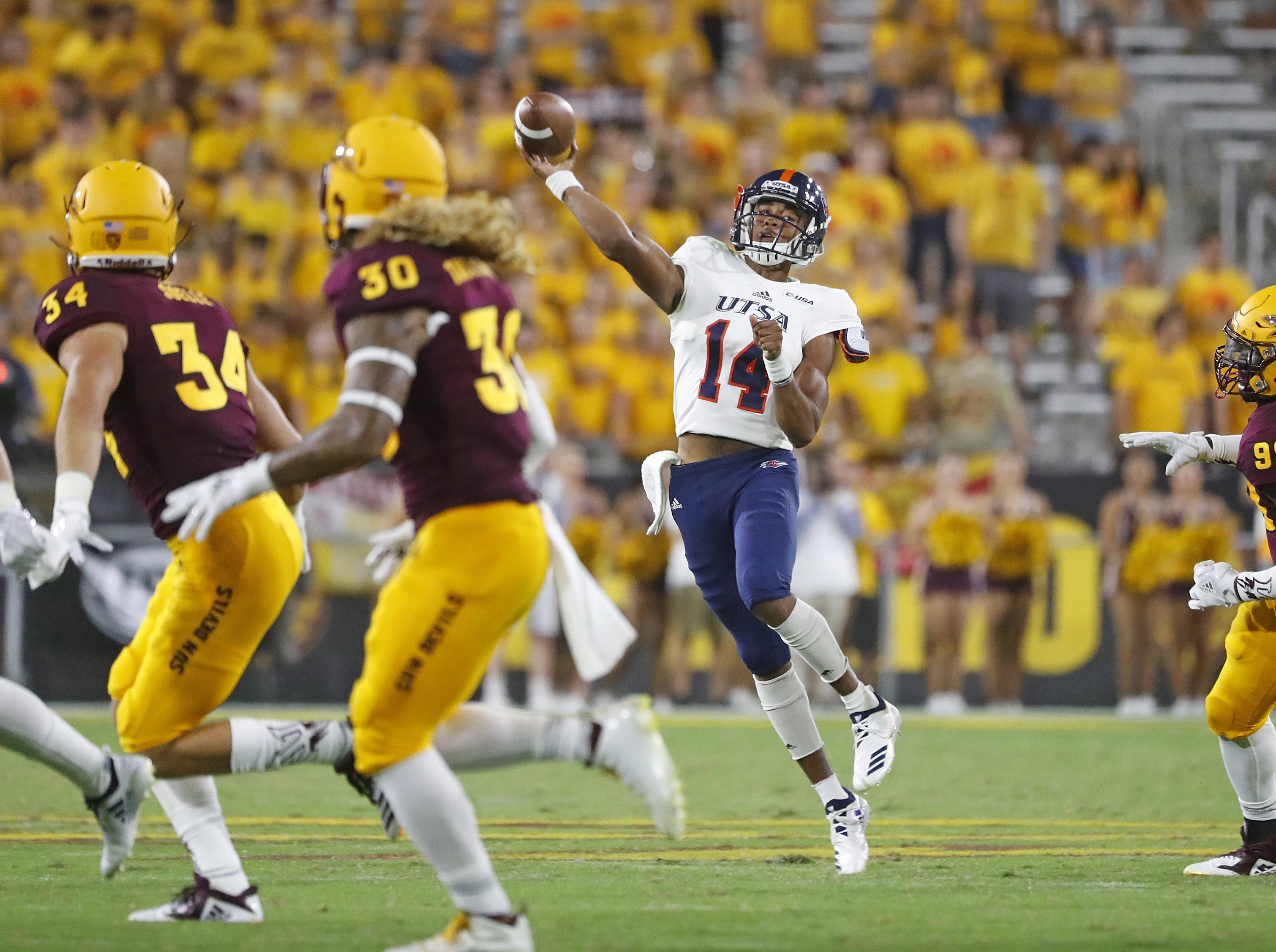 UTSA Roadrunners quarterback Cordale Grundy (14) throws a pass on the run against the Arizona State Sun Devils during the second half at Sun Devil Stadium in Tempe, Ariz. on Sept. 1, 2018.