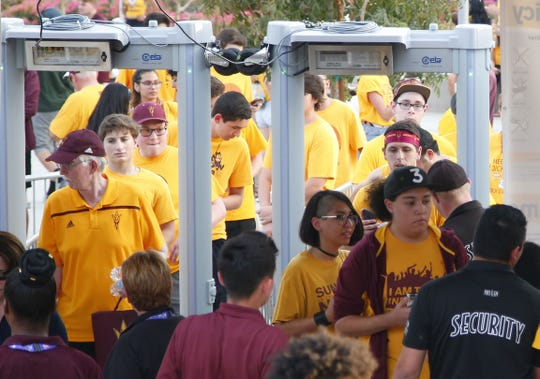 ASU fans enter through newly installed metal detectors at Sun Devil Stadium for the Texas-San Antonio game on Saturday, Sept. 1, 2018.