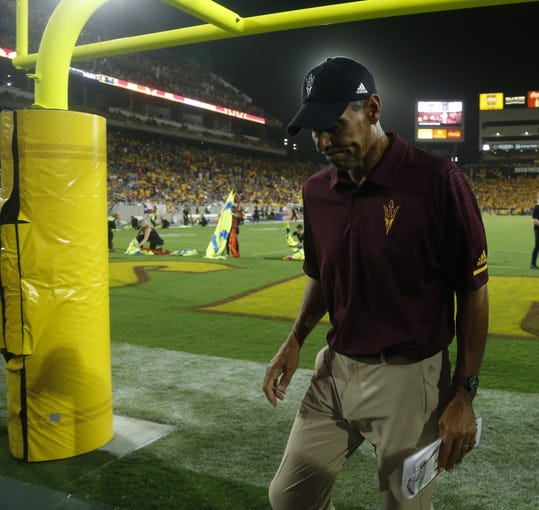 Arizona State Sun Devils head coach Herm Edwards walks off the field during the second half at Sun Devil Stadium in Tempe, Ariz. on Sept. 1, 2018.