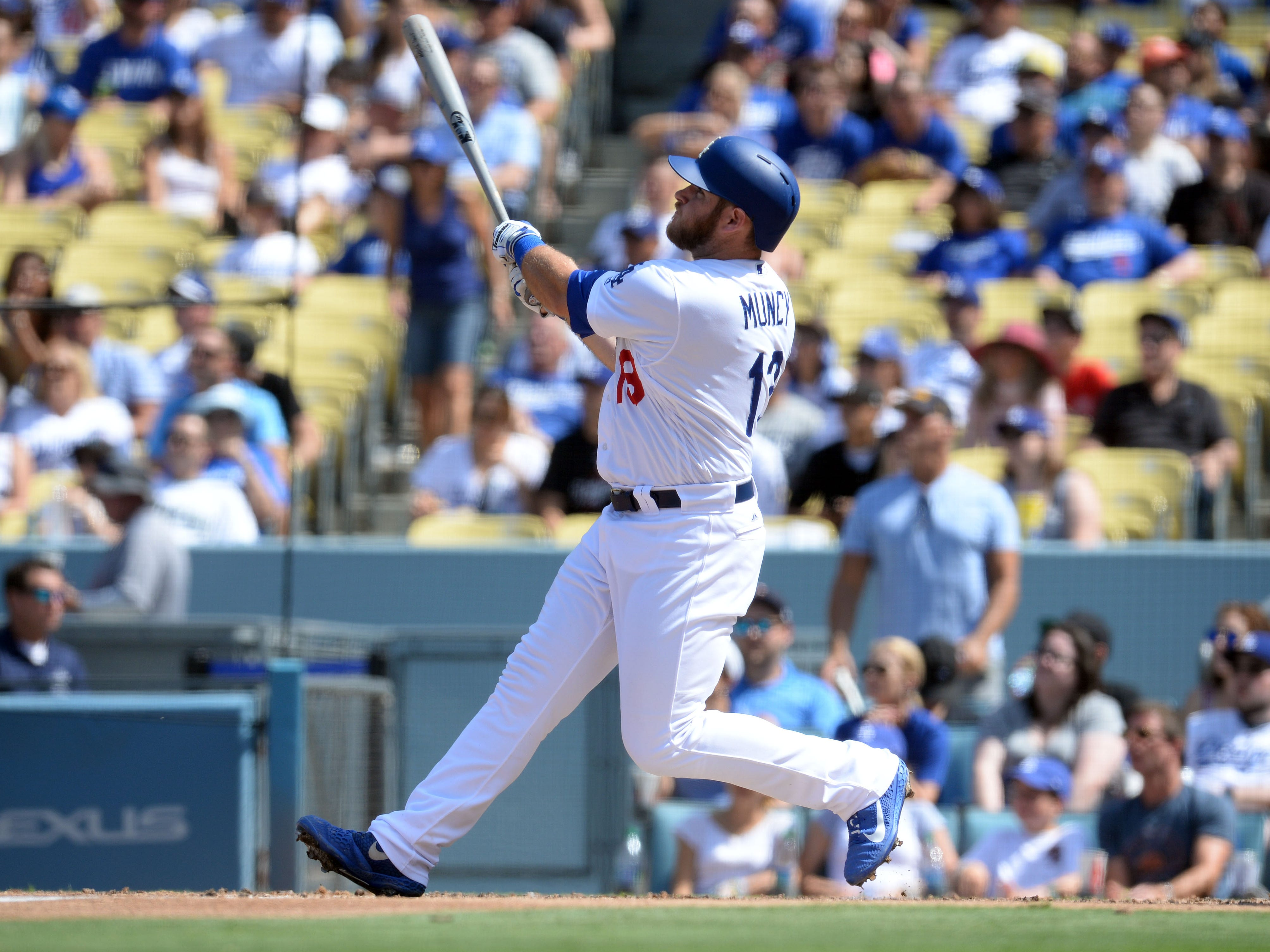 September 2, 2018; Los Angeles, CA, USA; Los Angeles Dodgers first baseman Max Muncy (13) hits a solo home run against the Arizona Diamondbacks in the fifth inning at Dodger Stadium. Mandatory Credit: Gary A. Vasquez-USA TODAY Sports