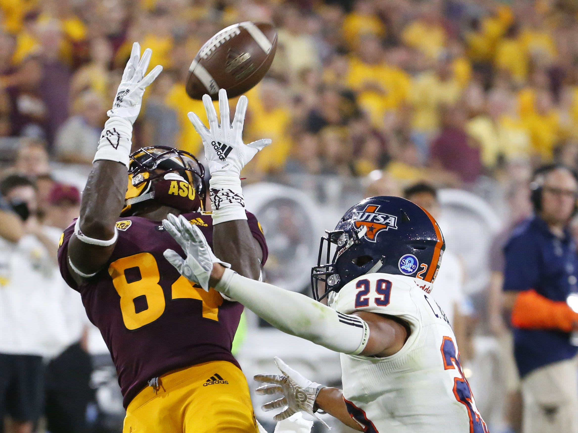 Arizona State Sun Devils wide receiver Frank Darby (84) completes a catch before being tackled by UTSA Roadrunners cornerback Clayton Johnson (29) during a football game at Sun Devil Stadium in Tempe on September 1, 2018.