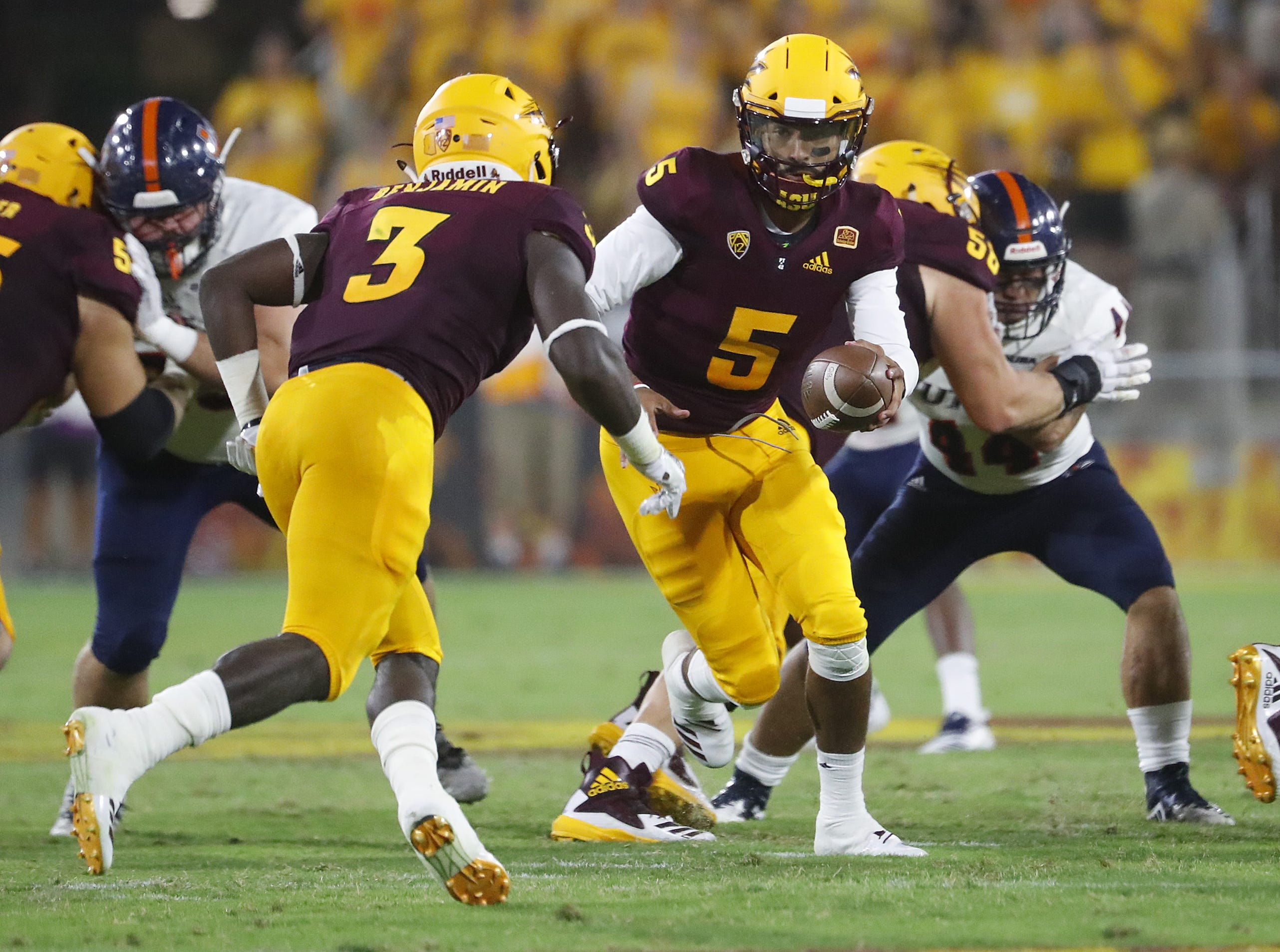 Arizona State Sun Devils quarterback Manny Wilkins (5) hands the ball off to Arizona State Sun Devils running back Eno Benjamin (3) during the first half against UTSA at Sun Devil Stadium in Tempe, Ariz. on Sept. 1, 2018.